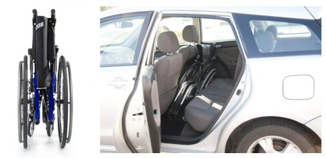 A folding wheelchair stowed in the back seat of a car